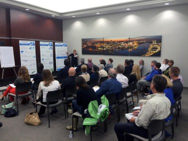 Camiros Consultant Arista Strungys speaking at the Downtown Open House Event