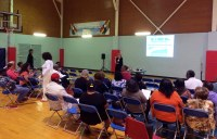 Community members view the UDC Presentation at the Valencia Park Community Center
